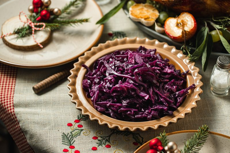 Close-up of red cabbage served on table. Christmas menu on dining table.